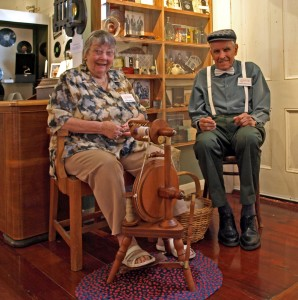 Jenny demonstrates spinning wool, while Harold tries to figure out how she does it.